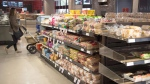 Various brands of bread sit on shelves in a grocery store in Toronto on Wednesday Nov. 1, 2017. THE CANADIAN PRESS/Doug Ives