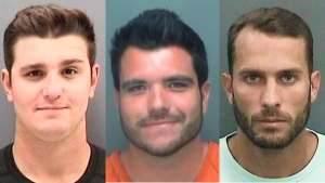 Florida wildlife officials and prosecutors have charged three men (left to right) Spencer Heintz, Michael Wenzel, and Robert Lee Benec, of Palmetto connected to a video of a shark being dragged behind a speeding boat. Wenzel is charged with two felony counts of aggravated animal cruelty. (Hillsborough County Sheriff's Office via AP)