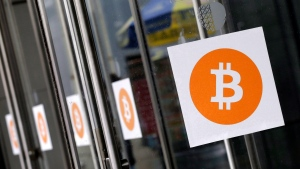 Bitcoin logos are displayed at the Inside Bitcoins conference and trade show, in New York on Monday, April 7, 2014. (THE CANADIAN PRESS/AP, Mark Lennihan)