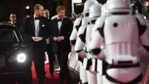 Prince William, Duke of Cambridge, left, and Prince Harry attend the European premiere of Star Wars: The Last Jedi, at the Royal Albert Hall, in central London, Tuesday, Dec. 12, 2017. The premiere is hosted in aid of The Royal Foundation of the Duke and Duchess of Cambridge and Prince Harry. (Eddie Mulholland/Pool Photo via AP)