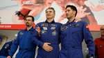 Italian astronaut Paolo Nespoli, center, is assisted by ESA space agency specialists pose for a photo at the airport of Karaganda, Kazakhstan, Thursday, Dec. 14, 2017. Three astronauts on Thursday landed back on Earth after nearly six months aboard the International Space Station. (AP Photo/Dmitri Lovetsky, Pool)