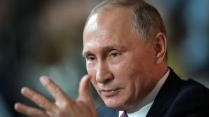 Russian President Vladimir Putin gestures during his annual news conference in Moscow, Russia, Thursday, Dec. 14, 2017. (Alexei Nikolsky, Sputnik, Kremlin Pool Photo via AP)