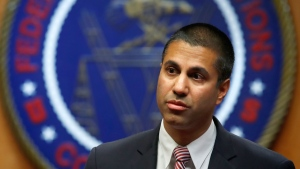 Federal Communications Commission (FCC) Chairman Ajit Pai arrives for an FCC meeting to vote on net neutrality, Thursday, Dec. 14, 2017, in Washington. (AP Photo/Jacquelyn Martin)