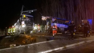In this photo provided by France Bleu, rescue workers help after a school bus and a regional train collided in the village of Millas, southern France, Thursday, Dec. 14, 2017. (Matthieu Ferri/France Bleu via AP)