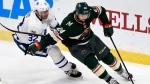 Minnesota Wild defenseman Matt Dumba (24) has the puck against Toronto Maple Leafs left wing Josh Leivo (32) during the second period of an NHL hockey game Thursday, Dec. 14, 2017, in St. Paul, Minn. (AP Photo/Hannah Foslien)