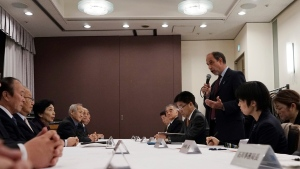 Tomas Quintana, standing, U.N. special rapporteur on the human rights situation in North Korea speaks to the families of Japanese abducted to North Korea during a meeting Friday, Dec. 15, 2017, in Tokyo. Japan froze the assets of 19 companies on Friday to step up pressure on North Korea to return Japanese citizens that it abducted in the 1970s and 1980s and to halt its nuclear weapons and missile development. (AP Photo/Eugene Hoshiko)