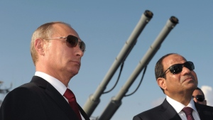 In this file photo taken on Tuesday, Aug. 12, 2014, Russian President Vladimir Putin, left, and Egyptian President Abdel-Fattah el-Sissi, visit missile cruiser Moskva ( Moscow) in the Russian Black Sea resort of Sochi, Russia. (Alexei Druzhinin, Sputnik, Kremlin Pool Photo via AP, file)