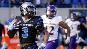In this Nov. 25, 2017, file photo, Memphis wide receiver Anthony Miller (3) heads for a touchdown against East Carolina in the first half of an NCAA college football game in Memphis, Tenn. FAU, Miami, Navy and Memphis are playing their bowl games on their home fields, and five other teams will play bowls in their home states. And that number could rise to six if Georgia makes the College Football Playoff championship game in Atlanta. (AP Photo/Mark Humphrey, File)