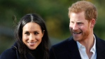 In this Dec. 1, 2017 file photo, Britain's Prince Harry and his fiancee Meghan Markle arrive at Nottingham Academy in Nottingham, England. Prince Harry's fiancee is set to join Britain's royal family for Christmas. Kensington Palace says Meghan Markle will join Queen Elizabeth II and other senior royals at Sandringham, a sprawling estate in Norfolk, 110 miles (175 kilometers) north of London, it was announced on Wednesday, Dec. 13, 2017.  (AP Photo/Frank Augstein, File)