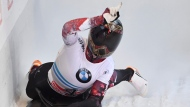 Canada's second placed Elisabeth Vathje celebrates in the finish area after the women's Skeleton World Cup race in Innsbruck, Austria, Friday, Dec. 15, 2017. (AP Photo/Kerstin Joensson)