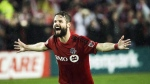 Toronto FC defender Drew Moor (3) reacts after defeating the Montreal Impact during overtime MLS eastern conference playoff soccer final action in Toronto on Wednesday, November 30, 2016. THE CANADIAN PRESS/Nathan Denette