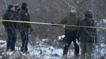 O.P.P officers can be seen near the Hydro One helicopter crash site in Tweed, Ont., on Dec. 14, 2017. Four Hydro One employees were killed Thursday in a helicopter crash in eastern Ontario, police and the utility reported.The crash occurred about noon in Tweed, north of Kingston, provincial police said. THE CANADIAN PRESS/Lars Hagberg