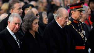 Prince Charles of Britain, left, former Spanish royals, Queen Sofia, second from left, King Juan Carlos I and Grand Duke Henri of Luxembourg, right, attend the funeral ceremony in tribute to late Romanian King Michael in Bucharest, Romania, Saturday, Dec.16, 2017. Tens of thousands of Romanians joined the European royals on Saturday to pay their respects to late King Michael as a state funeral got underway. Michael, who ruled Romania twice before being forced to abdicate by the communists in 1947, died at the age of 96 in Switzerland this month. (AP Photo/Vadim Ghirda)