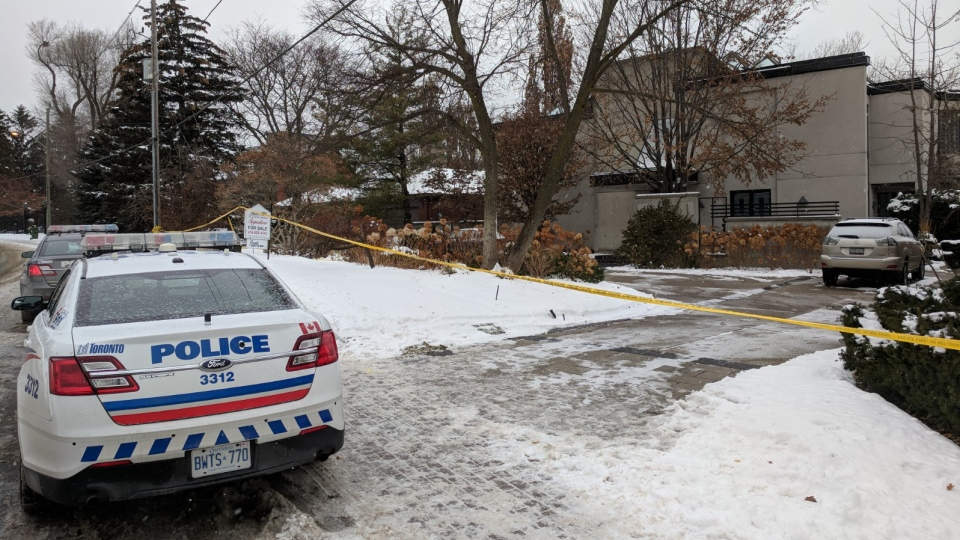 A police cruiser is shown outside a home belonging to Barry and Honey Sherman on Saturday. The billionaire couple were found dead on Friday afternoon. (Mary Nersessian/CTV News)