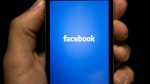 Facebook says that when people passively consume content on the platform, they feel worse. (AFP / BRENDAN SMIALOWSKI)