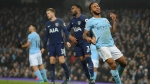 Manchester City's Raheem Sterling, foreground right, reacts after missing a scoring chance during the English Premier League soccer match between Manchester City and Tottenham Hotspur at Etihad stadium, in Manchester, England, Saturday, Dec. 16, 2017. (AP Photo/Rui Vieira)