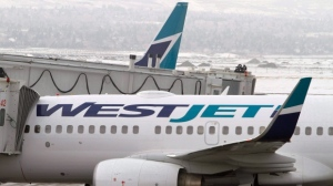 A WestJet plane sits on the tarmac at Calgary Airport on in this 2010 file photo. (Larry MacDougal / THE CANADIAN PRESS)