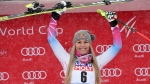 First placed United States' Lindsey Vonn celebrates on the podium of an alpine ski, women's World Cup super-G, in Val d'Isere, France, Saturday, Dec. 16, 2017. (AP Photo/Marco Tacca)