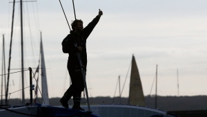 French skipper Francois Gabart celebrates after his world record, in the Brest harbor, western France, Sunday, Dec. 17, 2017. Gabart has broken the record for sailing around the world alone, circumnavigating the planet in just 42 days and 16 hours. (AP Photo/Thibault Camus)