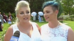In this image made from video, newlywed couple, Amy Laker, left, and Lauren Price are interviewed during their ceremony in Sydney, Saturday, Dec. 16, 2017. Two female couples tied the knot in Australia's first same-sex weddings under new legislation allowing gay marriages. January 9 had been expected to be the first possible date for same-sex weddings due to a four-week waiting period since the landmark law was passed. But the two couples were married in Sydney and Melbourne on Saturday after being granted permission to waive the notice period. Amy Laker, 29, and Lauren Price, 31, exchanged vows in Sydney because their families had to travel from Wales in the U.K. to attend what was to have been their commitment ceremony. (Channel 9 via AP)