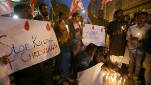 Pakistani Christians hold candles during a demonstration to condemn the Quetta's suicide attack on a church, in Karachi, Pakistan, Sunday, Dec. 17, 2017. Two suicide bombers attacked the church in Quetta when hundreds of worshippers were attending services ahead of Christmas. (AP Photo/Fareed Khan)