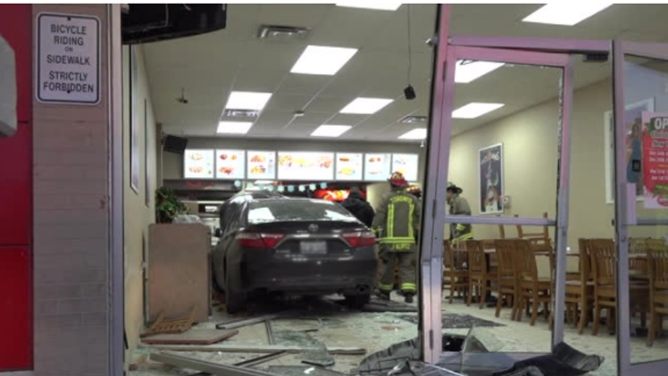 Firefighters respond after a car slammed into a pizza parlour in the Brookhaven-Amesbury area Sunday December 17, 2017.