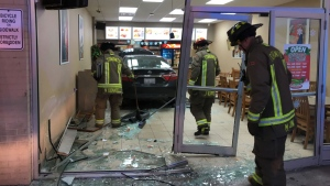 Firefighters respond after a car slammed into a pizza parlour in the Brookhaven-Amesbury area Sunday December 17, 2017. (Peter Muscat)
