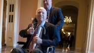 In this Dec. 1, 2017 file photo, Sen. John McCain, R-Ariz., leaves a closed-door session where Republican senators met on the GOP effort to overhaul the tax code, on Capitol Hill in Washington.  (AP Photo/J. Scott Applewhite, File)
