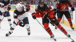 Team Canada's Haley Irwin (21) is chased by Team USA's Monique Lamoureux-Morando (7) during second period National Women's Team series hockey action in Edmonton, Alta., on Sunday December 17, 2017. THE CANADIAN PRESS/Jason Franson