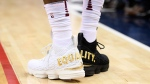 """Cleveland Cavaliers forward LeBron James' shoes are emblazoned with """"EQUALITY"""" on both heels during the first half of an NBA basketball game against the Washington Wizards, Sunday, Dec. 17, 2017, in Washington. (AP Photo/Nick Wass)"""