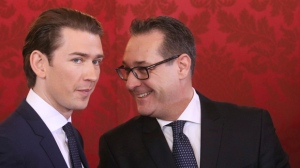 Newly sworn-in Austrian Chancellor Sebastian Kurz, left, and new Vice Chancellor Heinz-Christian Strache talk during the swearing-in ceremony of the new Austrian government led by a conservative and a nationalist party in Vienna, Austria, Monday, Dec. 18, 2017. (AP Photo/Ronald Zak)