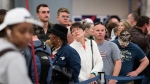 People wait in line to rebook flights at Hartfield-Jackson Atlanta International Airport , Monday, Dec. 18, 2017, in Atlanta. (AP Photo John Amis)