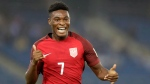 The United States' Ayo Akinola celebrates a goal against Ghana during the FIFA U-17 World Cup match in New Delhi, India, Monday, Oct. 9, 2017. Toronto FC has signed highly touted teenage forward Ayo Akinola, a U.S. under-17 international, as a homegrown player. THE CANADIAN PRESS/AP-Tsering Topgyal