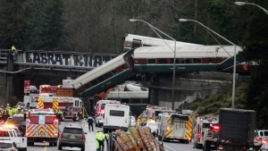 A derailed train is seen on southbound Interstate 5 on Monday, Dec. 18, 2017, in DuPont, Wash. (AP Photo/Rachel La Corte)