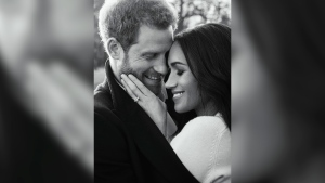 In this photo released by Kensington Palace on Thursday, Dec. 21, 2017, Prince Harry and Meghan Markle pose for one of two official engagement photos, at Frogmore House, in Windsor, England. (Alexi Lubomirski via AP)