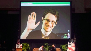Edward Snowden appears on a live video feed broadcast from Moscow at an event sponsored by ACLU Hawaii in Honolulu on Feb. 14, 2015. THE CANADIAN PRESS/AP, Marco Garcia