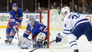Toronto Maple Leafs goalie Frederik Andersen (31) stops a shot by New York Rangers left wing Jimmy Vesey (26) during the second period of an NHL hockey game Saturday, Dec.23, 2017, at Madison Square Garden in New York. (AP Photo/Bill Kostroun)