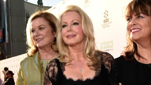 "In this March 26, 2015, file photo, Heather Menzies-Urich, from left, Kym Karath and Debbie Turner, cast members in the classic film ""The Sound of Music,"" pose together before a 50th anniversary screening of the film at the opening night gala of the 2015 TCM Classic Film Festival in Los Angeles. (Photo by Chris Pizzello/Invision/AP, File)"