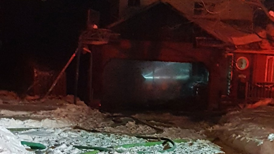 The aftermath of a garage fire at a home on Goldie Drive in Orillia is pictured Monday December 25, 2017. (@Tammad /Twitter)