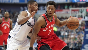Toronto Raptors guard Kyle Lowry (7) dribbles against Dallas Mavericks guard Dennis Smith Jr. during the first half of an NBA basketball game in Dallas, Tuesday, Dec. 26, 2017. (AP Photo/LM Otero)