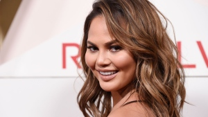 In this Nov. 2, 2017 file photo, model Chrissy Teigen poses at the 2017 Revolve Awards at the Dream Hollywood hotel in Los Angeles.  (Photo by Chris Pizzello/Invision/AP,File)