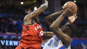 Oklahoma City Thunder's Jerami Grant (9) tries to shoot over Toronto Raptors' Serge Ibaka during the second half of an NBA basketball game in Oklahoma City, Wednesday, Dec. 27, 2017. (AP Photo/Kyle Phillips)
