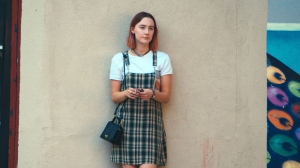 "This file image released by A24 Films shows Saoirse Ronan in a scene from ""Lady Bird."" Ronan says she hopes that her latest film '""Lady Bird'"" helps people to feel understood in the same way HBO show' ""Girls'"" helped her. (Merie Wallace/A24 via AP, File)"