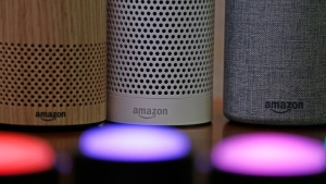 In this Wednesday, Sept. 27, 2017, file photo, Amazon Echo and Echo Plus devices, behind, sit near illuminated Echo Button devices during an event announcing several new Amazon products by the company, in Seattle.  (AP Photo/Elaine Thompson, File)