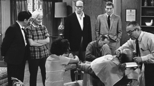"In this April 11, 1963, file photo, standing from left, Morey Amsterdam, Rose Marie, and Richard Deacon, and Dick Van Dyke, right, gather around Carl Reiner, in barber chair during a rehearsal of an episode for the ""The Dick Van Dyke Show."" (AP Photo/David F. Smith, File)"