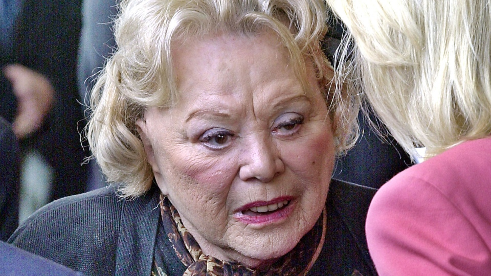 In this April 1, 2002, file photo, actress and comedian Rose Marie talks to the press as she arrives for a ceremony honoring comedian Milton Berle at Hillside Memorial Park and Mortuary in Los Angeles. (AP Photo/Nick Ut, File)