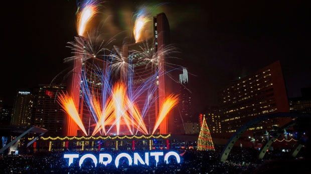 Fireworks go off to mark the beginning 2016 during New Years Eve celebrations held at Nathan Phillips Square in Toronto, Friday, Jan 1, 2016. THE CANADIAN PRESS/Marta Iwanek