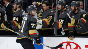 Vegas Golden Knights center William Karlsson (71) celebrates after scoring a hat trick against the Toronto Maple Leafs during the third period of an NHL hockey game, Sunday, Dec. 31, 2017, in Las Vegas. (AP Photo/John Locher)