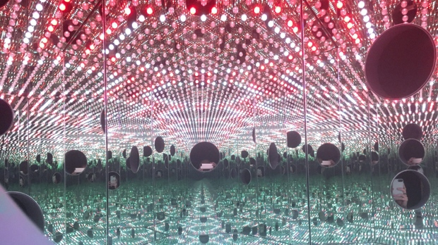 "In this Nov. 21, 2017 photo, colored lights appear in the Infinity Mirror Room created by Japanese artist Yayoi Kusama, part of the exhibit, ""Yayoi Kusama: Festival of Life,"" on display at the David Zwirner gallery in the Chelsea section of New York. The exhibit runs through Dec. 16. (AP Photo/Jocelyn Noveck)"
