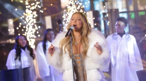 Mariah Carey performs on stage at the New Year's Eve celebration in Times Square on Sunday, Dec. 31, 2017, in New York. (Photo by Brent N. Clarke/Invision/AP)